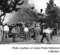 Fire Department fighting a house fire, Photo courtesy of Jones Photo Historical Collection